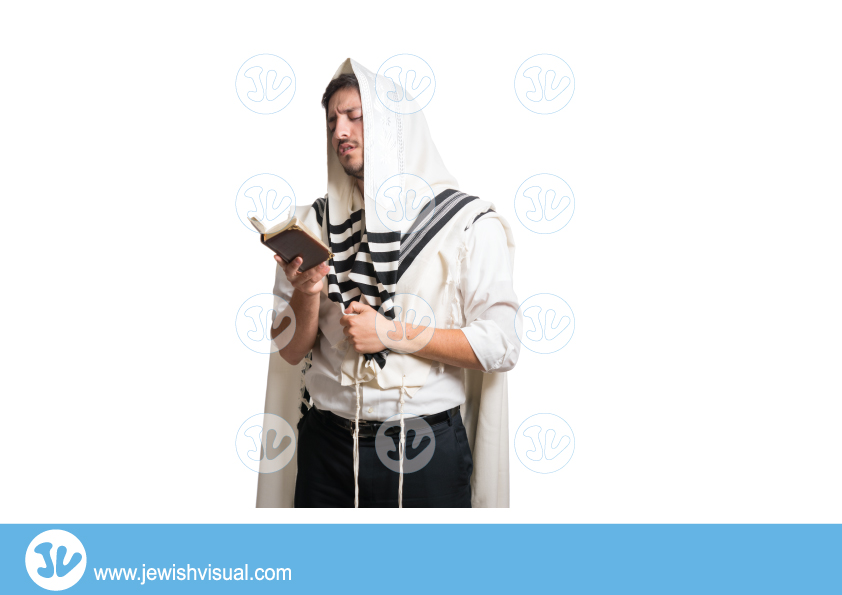 Man praying with talit over his head and siddur – איש מתפלל עם טלית שמכסה את הראש וסידור ביד